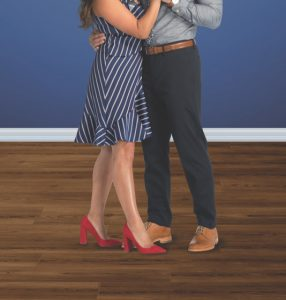 Couple dancing on coretec waterproof floor | Andy's 5 Star Flooring