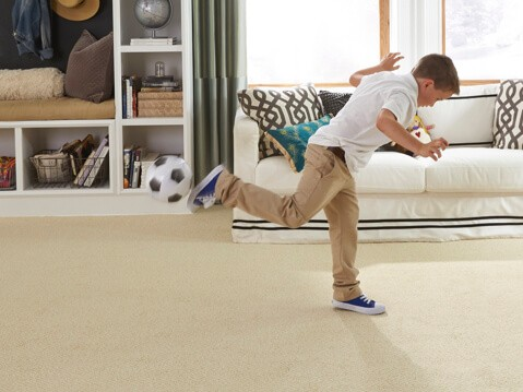 Boy playing on stainmaster | Andy's 5 Star Flooring