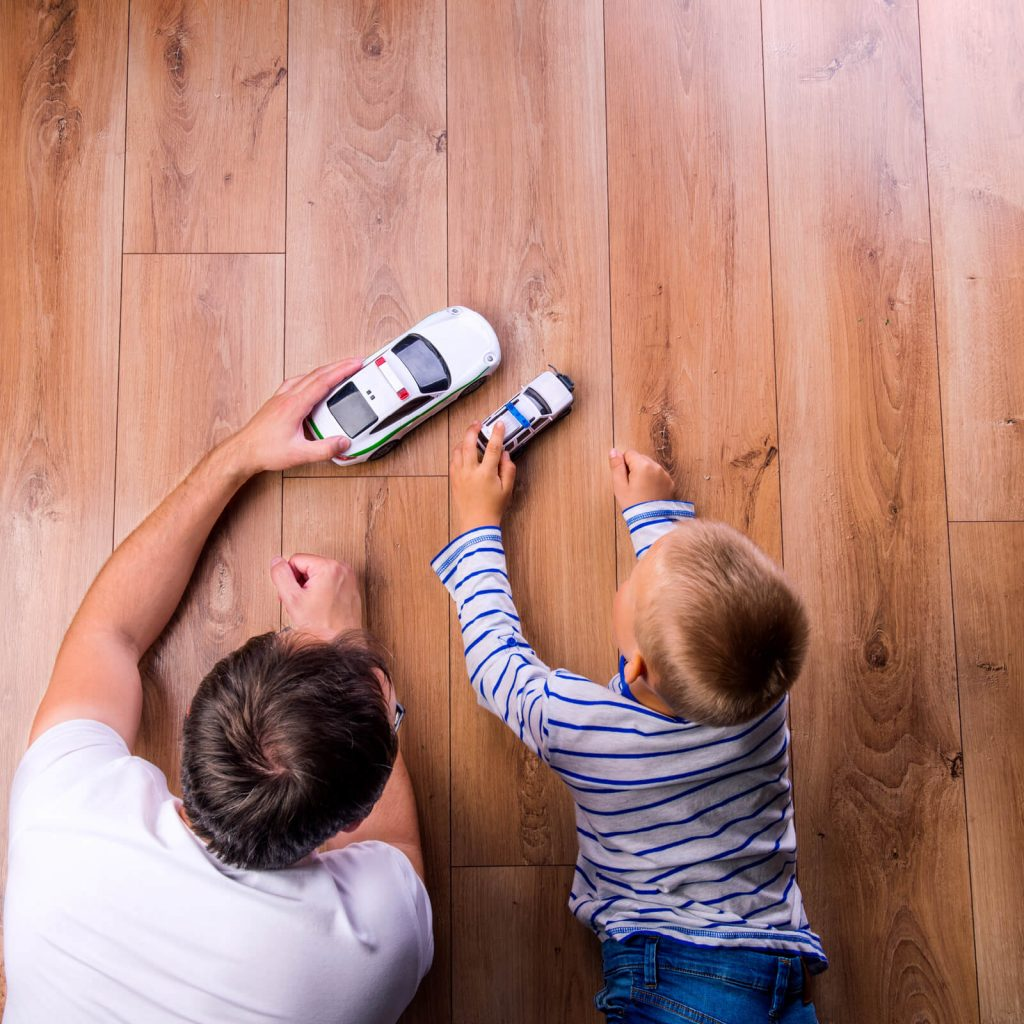 Father with kid playing with toycar | Andy's 5 Star Flooring